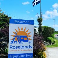 Roselands caravan park new logo and sign 2019