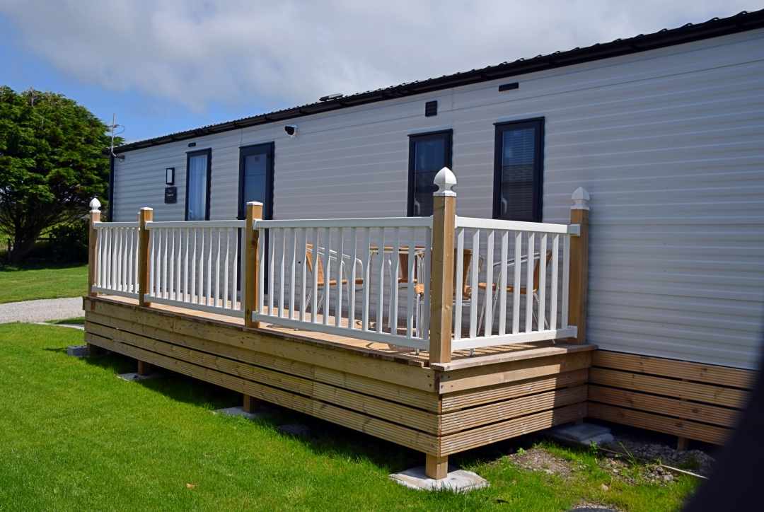 Coster holiday home Decking view at rear